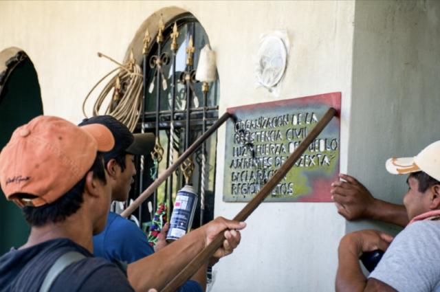 Three compañeros marking the house of a new activist with the Luz y Fuerza del Pueblo seal - Taniperla, Chiapas. March 2017.