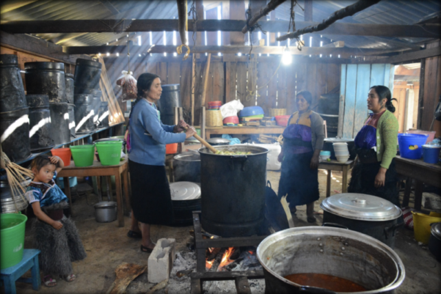 Three Tzotzil women and a little girl preparing a meal for over 100 persons at a public forum organized by Luz y Fuerza del Pueblo - La Candelaria, San Cristóbal de las Casas, Chiapas. December 2016.